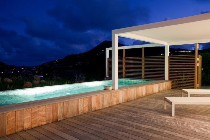 Pool and deck at night.