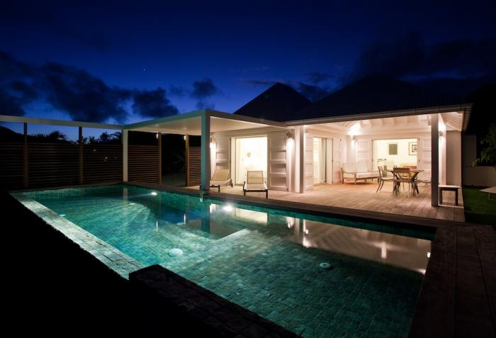 Pool and villa at night.