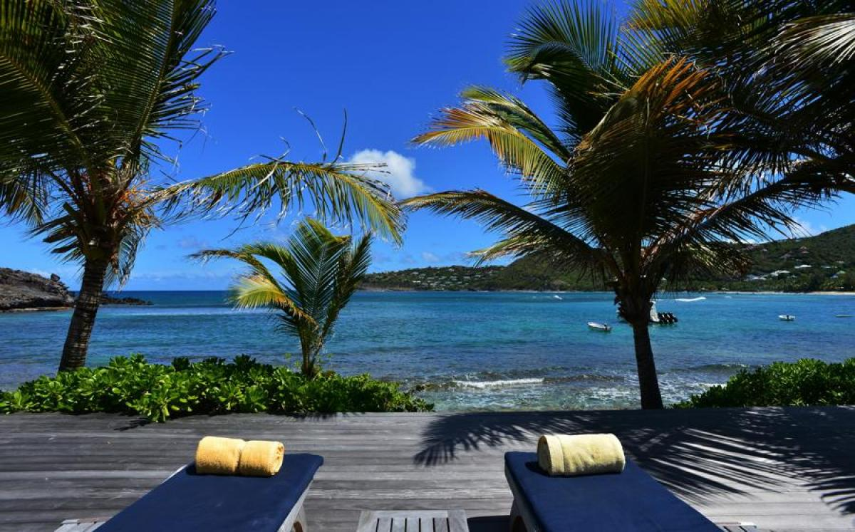 From the beachfront deck you can relax and enjoy the views of the Caribbean