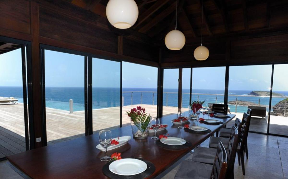 Glass doors open to the views in the dining area