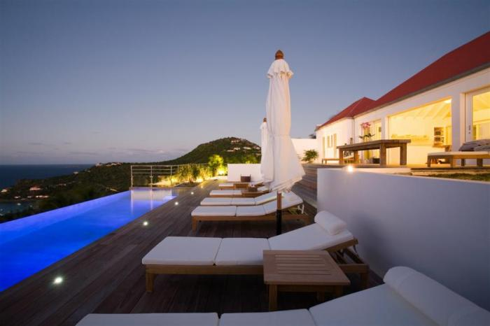 The deck and Infinity pool at night.