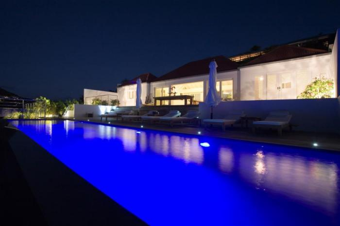 The pool lights up beautifully at night!