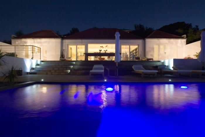 The villa and pool at night.