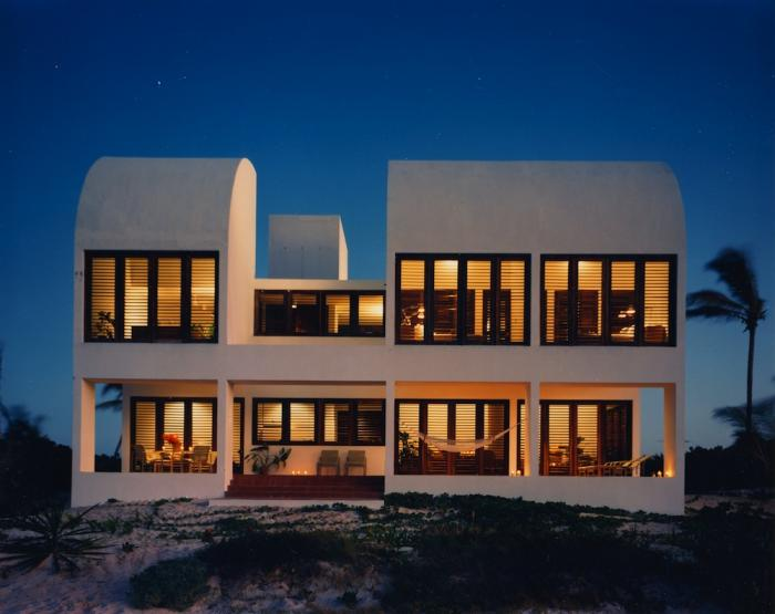 Covecastles beach villa at night.