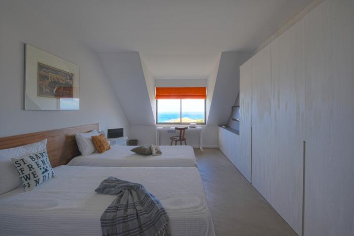 Bedroom with twin beds and ocean views.