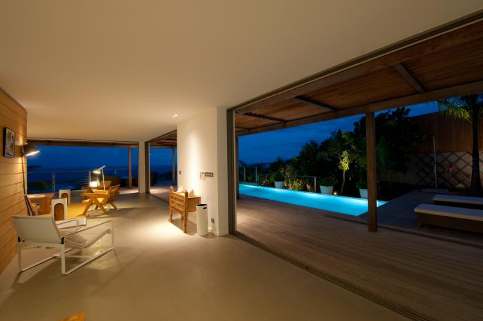 Terrace and pool at night.