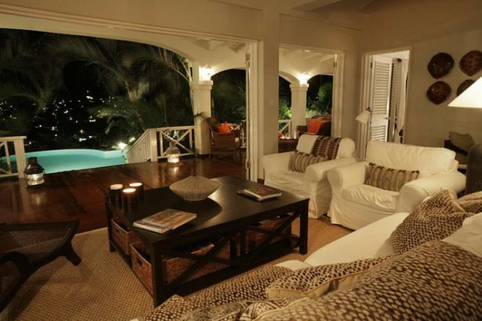The living room looking out to the pool at night.