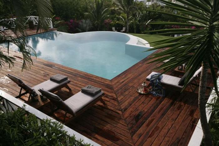 Pool with deck lounge seating.