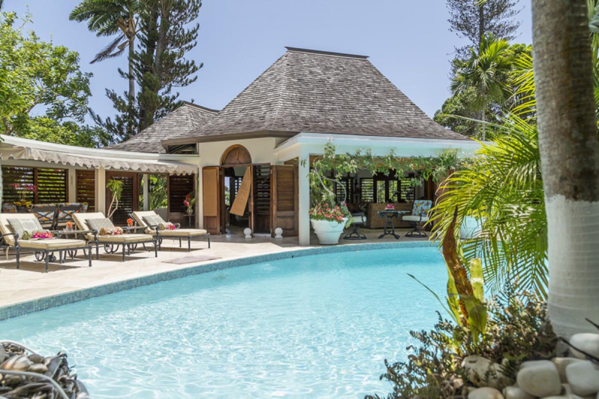 Luxurious pool and patio areas at Coo Yah Villa
