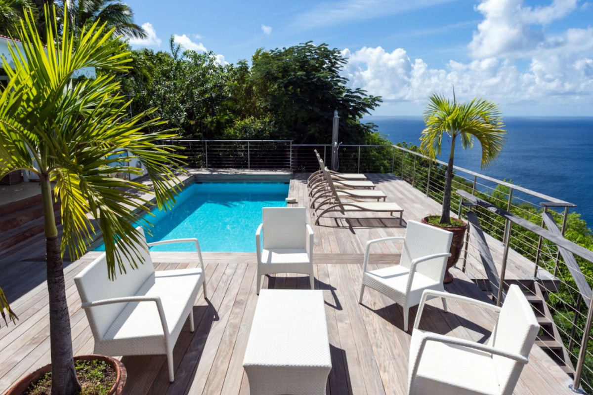 Lush tropical gardens surround the pool at Ti Moun villa