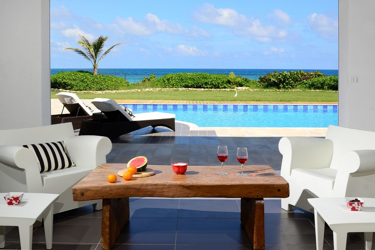 Relax ay Villa Venus in the pool that is only steps away from the beach