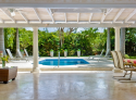 Open terrace overlooks Amberley's private pool