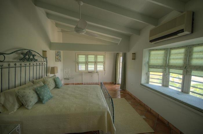 This bedroom has A/C and a ceiling fan for added comfort.