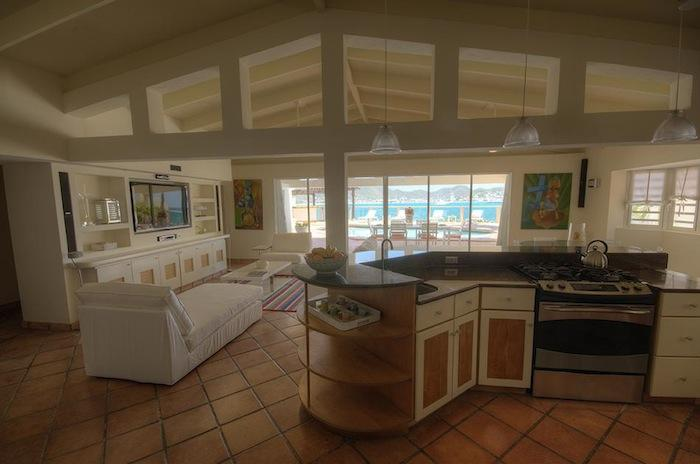 Kitchen overlooking the living room and pool deck.