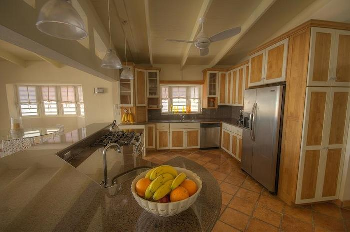 The kitchen is spacious and fully equipped.