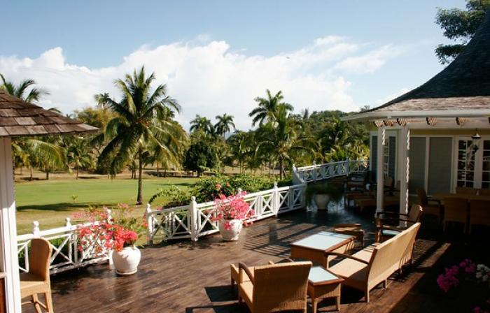 Spacious deck with tropical golf course views.