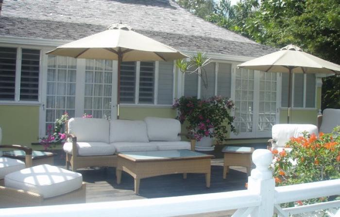 Decking seating with umbrellas for shade.