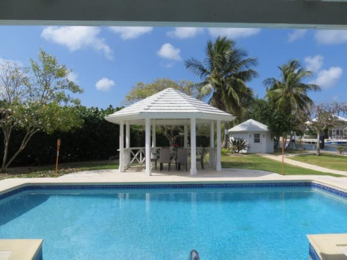 View of the poolside gazebo and garden.