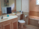 Ensuite bathroom with tub/shower combo.