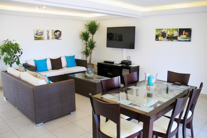 The living and dining areas can all enjoy the flat screen TV.
