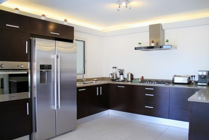 The kitchen is modern and fully equipped for your every cooking need.