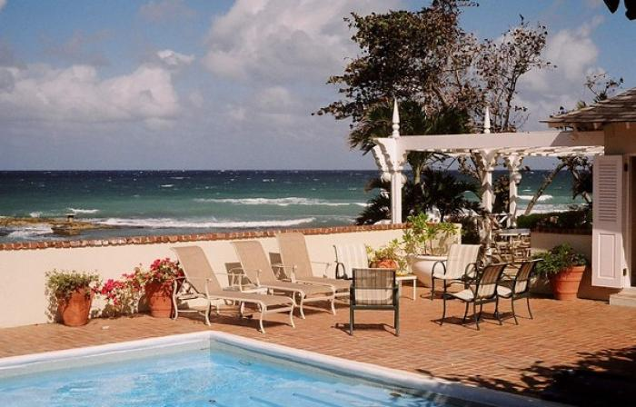 Seaspray Villa is a beachfront home with a large pool and hot tub.