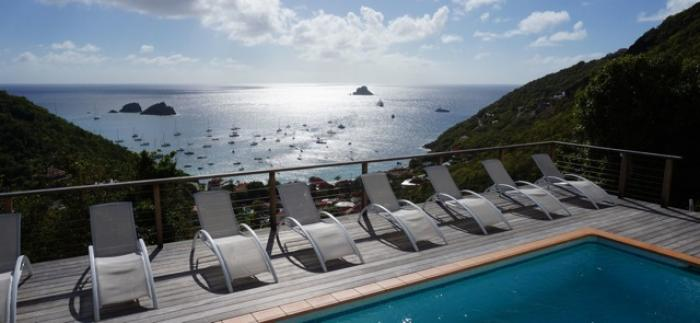 Mon Plaisir enjoys panoramic ocean views overlooking Gustavia harbor and Corossol Bay.