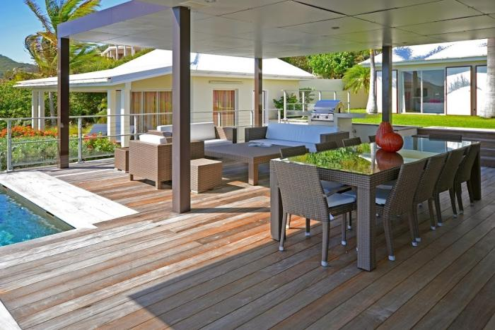 Alternate view of the outdoor living and dining areas.