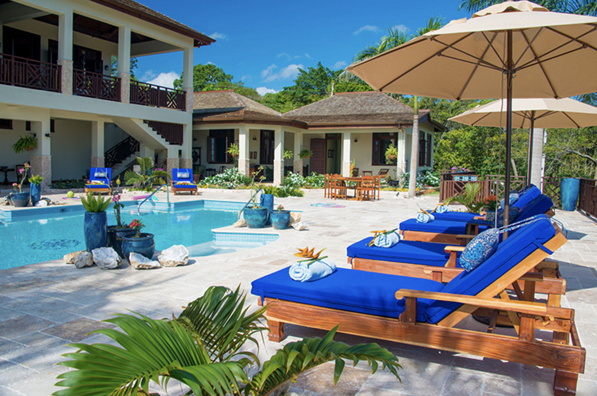 Relaxing poolside at Jubilation Villa