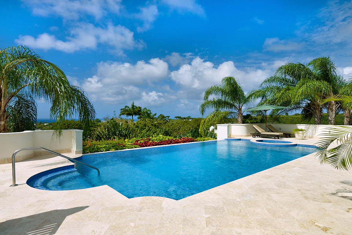 Relaxing pool surrounded by tropical beauty at Ragamuffins House