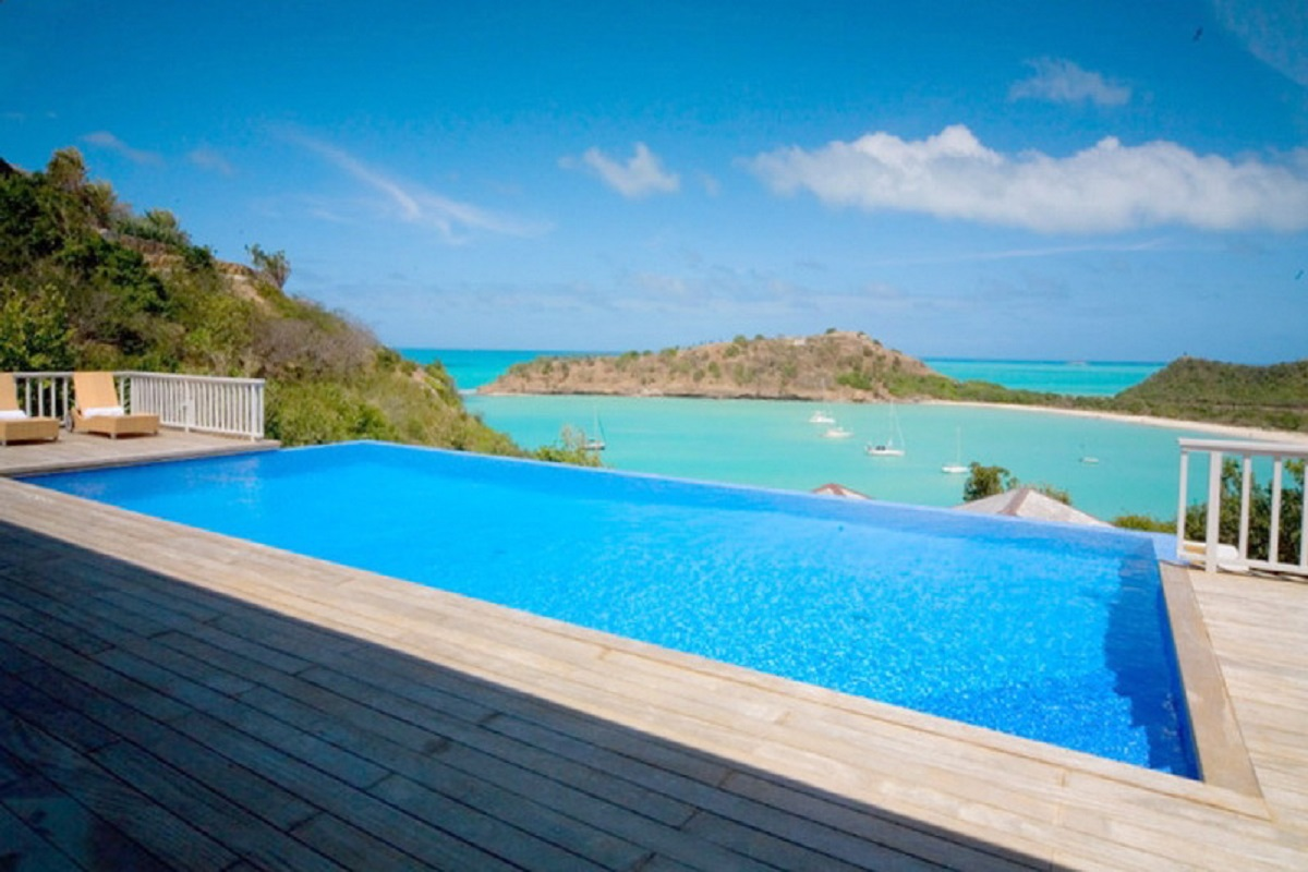 Enjoy beautiful views of the Caribbean from the pool deck at Capri Villa